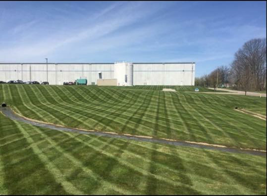 Large commercial lawn mowed by Delaware Landscape company