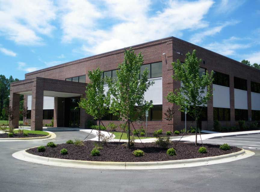 Landscaped parking lot near front entrance of building by Columbus landscape company.