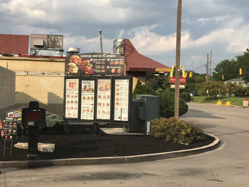 Mulch bed near restaurant drive through by Delaware landscape company.