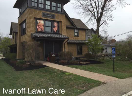 Salon front yard with sidewalk from complete lawn maintenance package from Ivanoff.