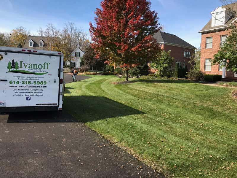 Trailer of Ivanoff Lawn Care and Landscaping near recently mowed lawn.