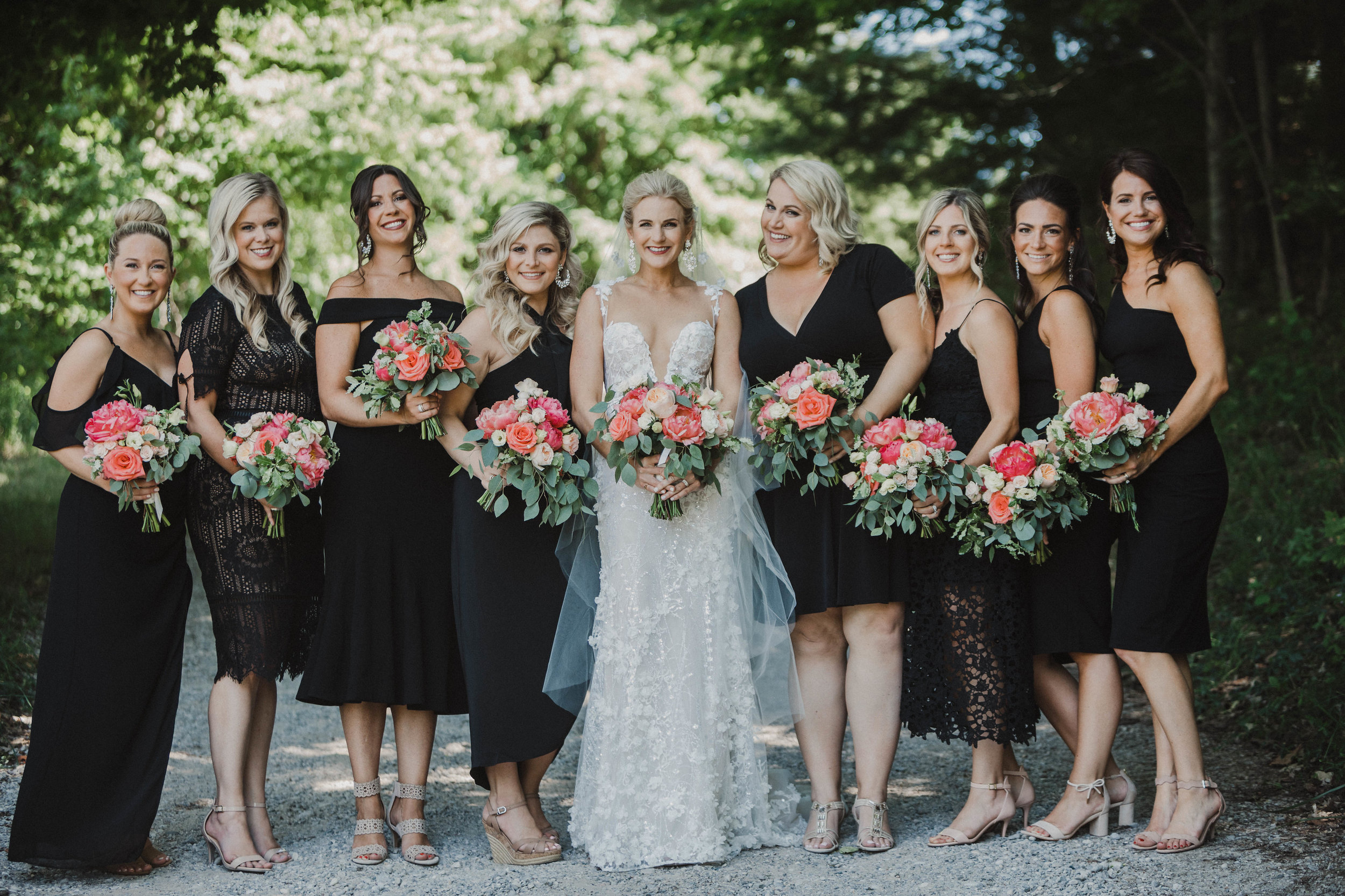 Just look at those bouquets filled with Coral Peonies!