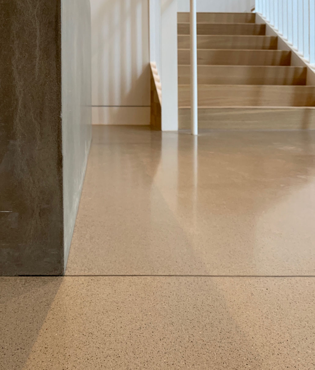 A polished concrete floor with a grouted saw cut line. These contrasting grout lines both accent the decorative cuts and eliminate cleaning issues.