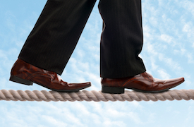 bigstock-Businessman-on-a-tightrope-con-49063478.jpg