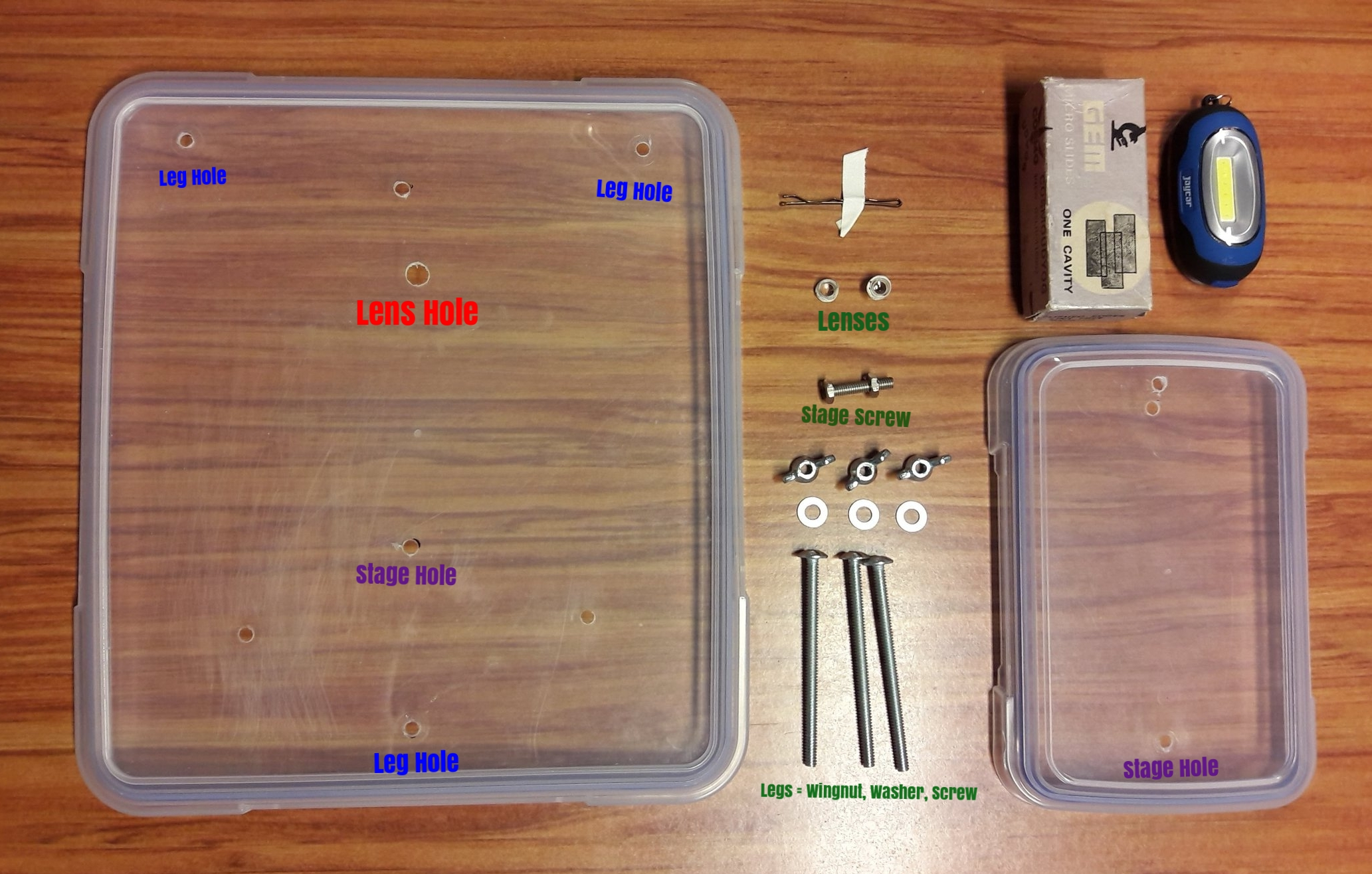 You will need: Sistema 5L lid, Sistema 1L lid, long carriage screws (3), washers (3), wing nuts (3), short carriage screw, bolt to hold on short screw, laser pointed lens (1 or 2), small LED light (optional), glass specimen slides (optional), bobby pin with tape (optional).   The five unmarked holes  were practice ones which did not work...you don't need them.