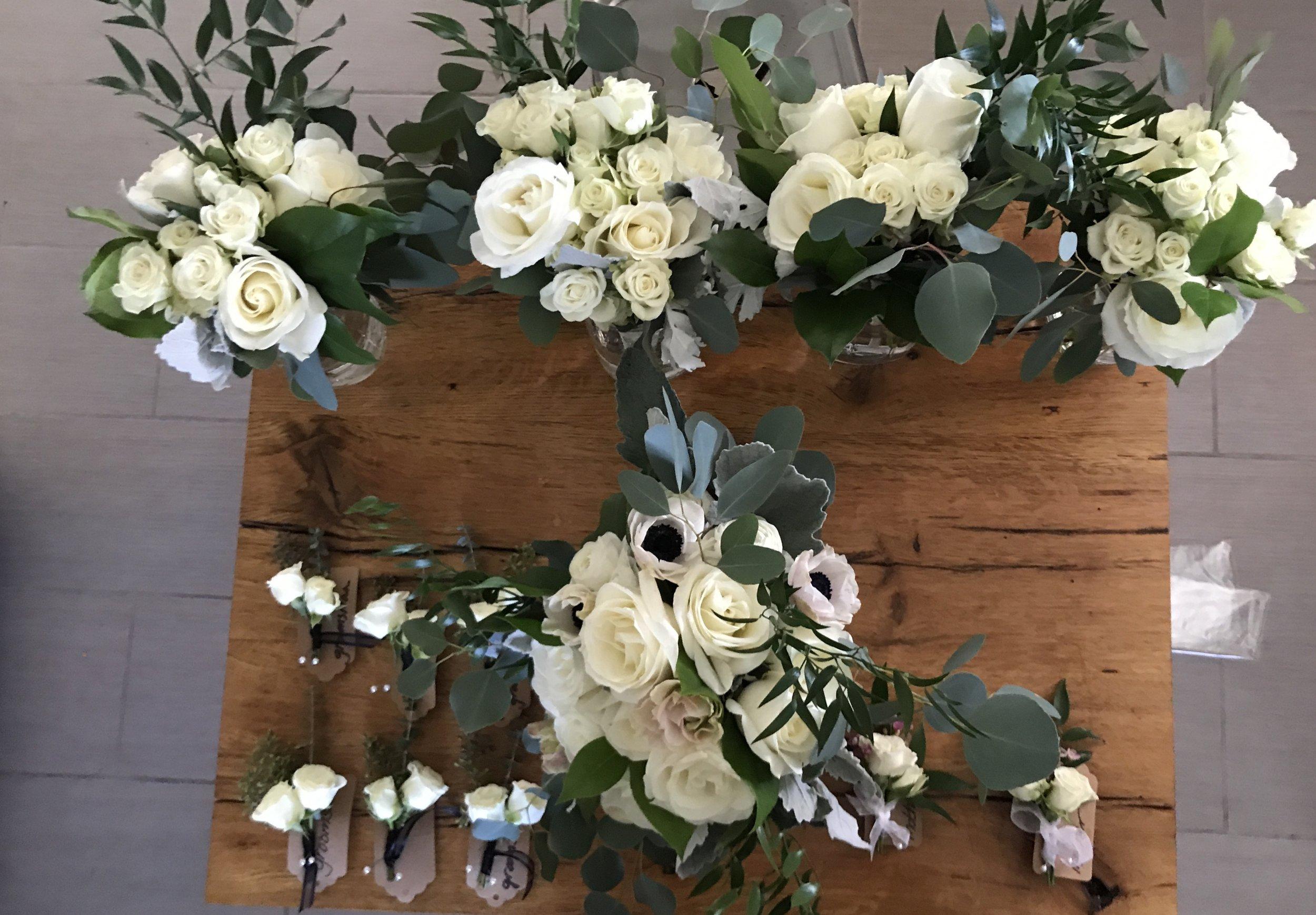 Bride's bouquet. bridesmaids bouquets, boutonnières, and corsages.