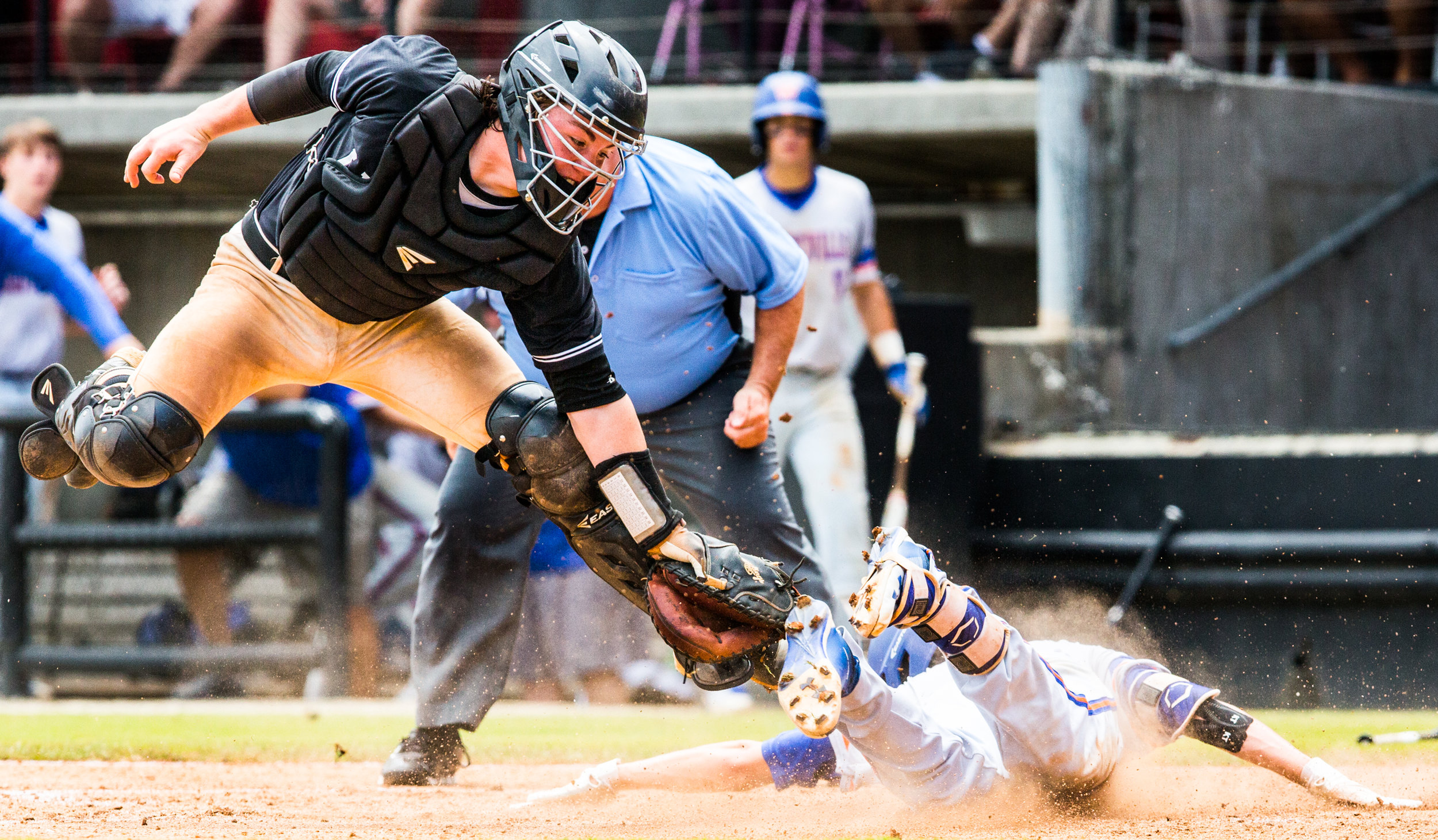 Ledford's Avery Cain (left) attempts a tag on Whiteville's Brooks Baldwin as he safely arrives at home for an inside-the-park home run during their game on Saturday morning at Five County Stadium in Zebulon. [Dan Busey/The Dispatch]