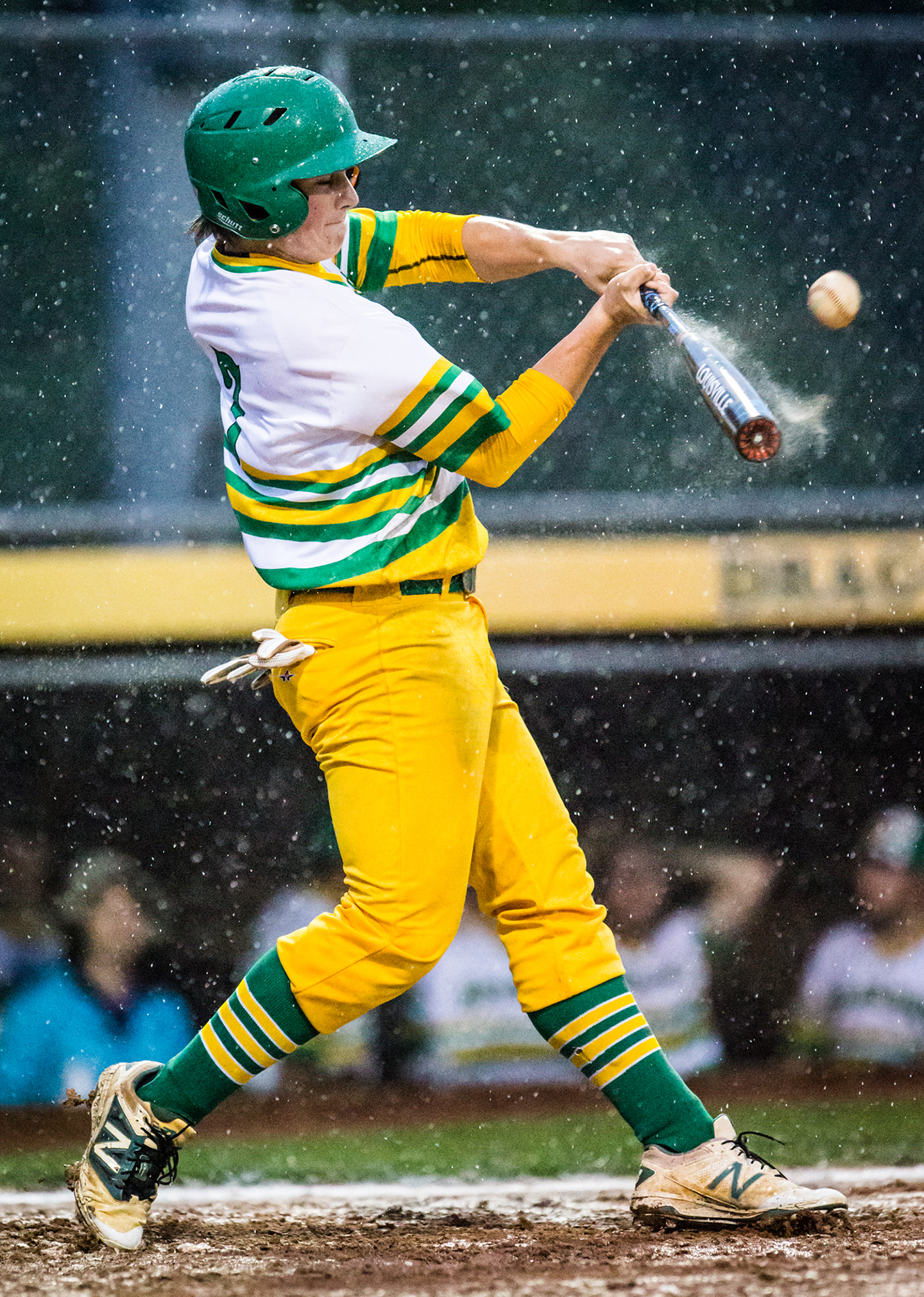 West Davidson's Austin Musgrave bats against Central Davidson in the rain during their game on April 26, 2018 at West Davidson High school in Lexington, North Carolina. [Dan Busey/The Dispatch]