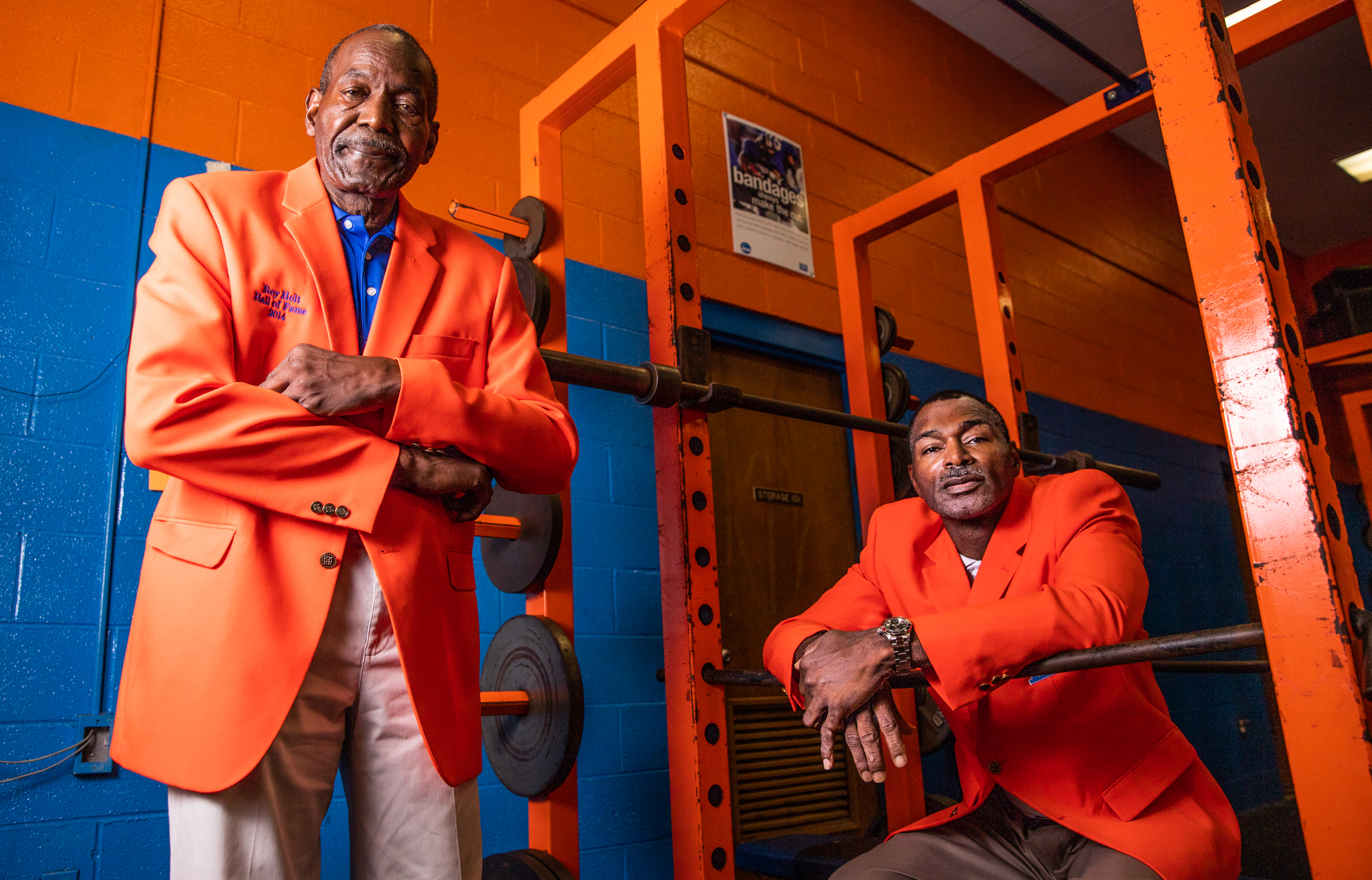 """Ron """"Tippy"""" Holt, left, and Rory Holt pose for a portrait in the men's weight room at Lexington Senior High on October 1, 2018 in Lexington, North Carolina. The Holts are the first father-son duo to be inducted into the Lexington Senior High School Sports Hall of Fame. [Dan Busey/The Dispatch]"""