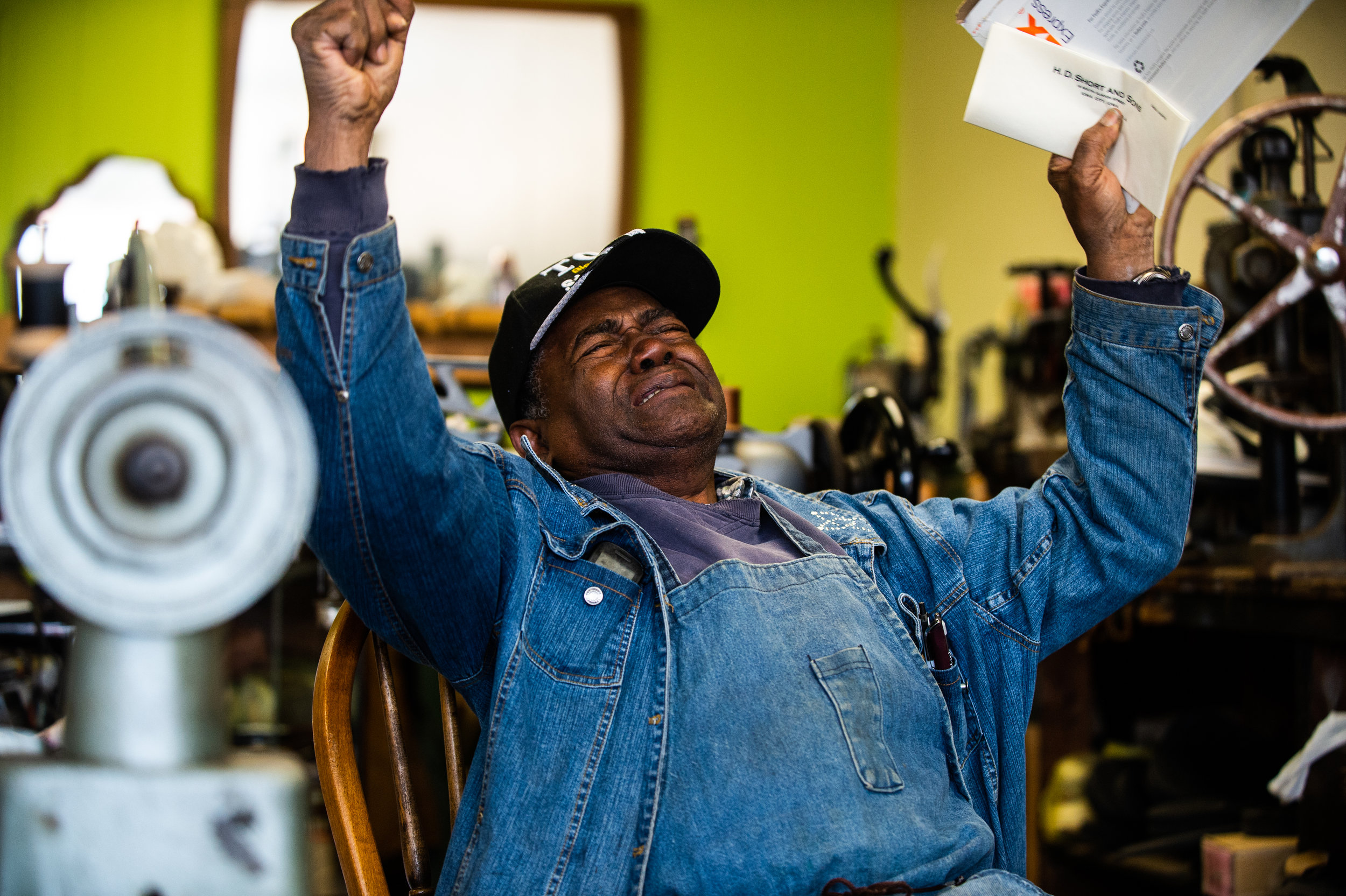 Jim Blackburn, 82, of Decatur Shoe Repair reacts December 6, 2018 at his Fourth Avenue Southeast business after receiving a check for $5,000 to replace machinery that was stolen from him in Decatur, Ala.
