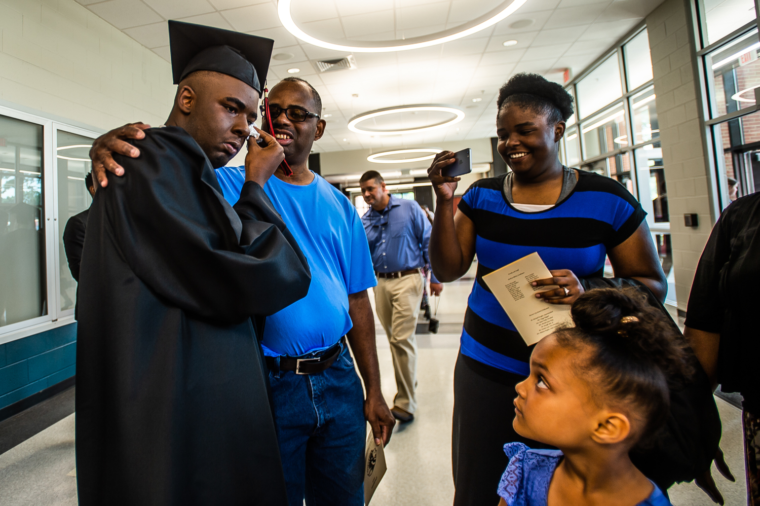 """Family greets an emotional Anthony Jacquez Robinson after he graduated Decatur High School on May 16, 2019, in Decatur, Ala. """"He talks softly, but is a leader and the big man on campus,"""" said lead administrator Mary Hillis at Decatur High Developmental. Robinson, who is classified as developmentally delayed, is leaving Decatur High Developmental, but not to be confined to a life at home. He's one of the first students selected to participate in the Project SEARCH program at Decatur Morgan Hospital. The program, which started in 1996 at Cincinnati Children's Hospital Medical Center, secures employment for people with disabilities."""