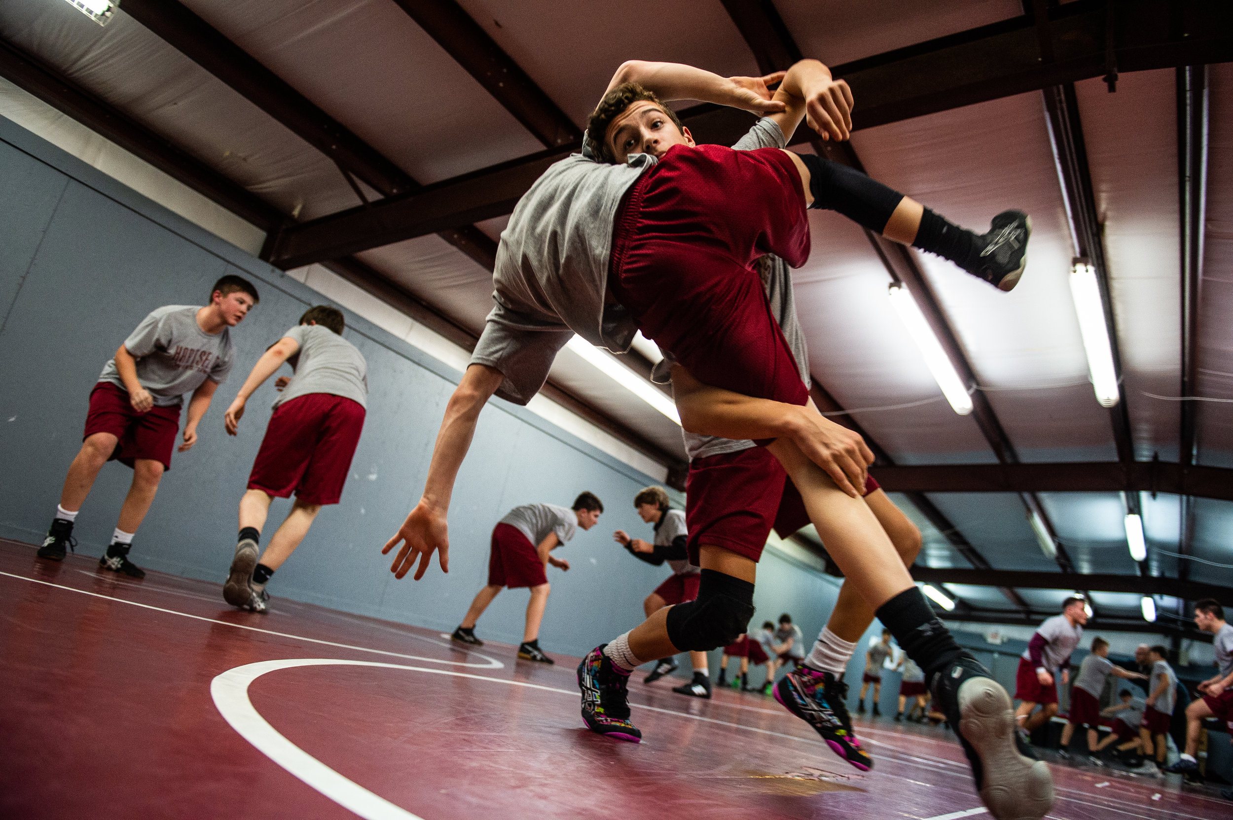 Student Payton Roberts tackles teammate Ethan England for an exercise drill during Hartselle Junior High's wrestling practice December 19, 2018, at Hartselle Junior High in Hartselle, Ala.