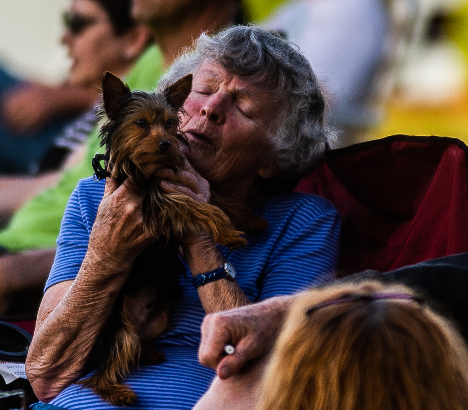 Phyllis Prichard sings along to a song to Bear her Yorkshire Terrier during the Concerts by the River at Rhodes Ferry Park in Decatur, Ala. on May 6, 2019.