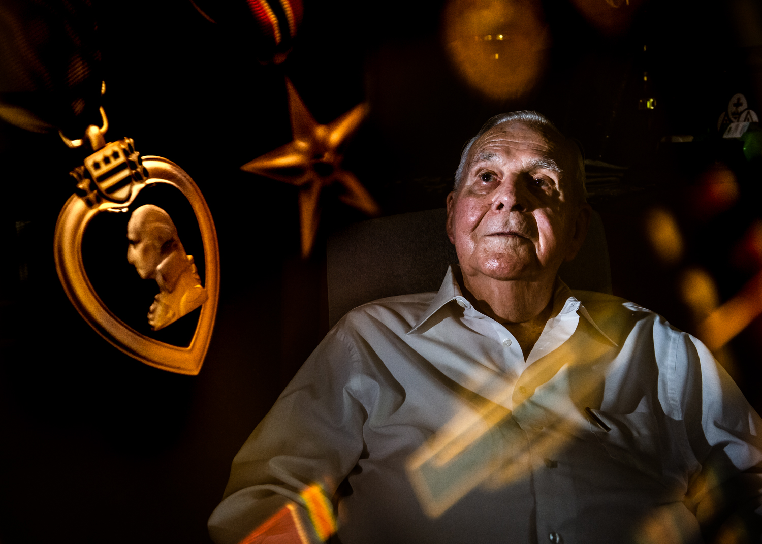 In this multiple exposure, George Mills, 98, at his home in Decatur, Ala. on May 24, 2019 is surrounded by military decorations he was awarded for his acts in World War II.