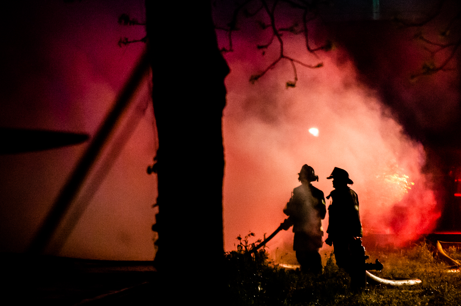 Firefighters are silhouetted in a cloud of smoke as they respond to the back side of Court Street Grill on April 22, 2019 in Moulton, Ala. The fire began in the Court Street Grill damaged at least two buildings housing businesses and offices on Moulton's historic courthouse square. The restaurant was fully engulfed in flames at 10:20 p.m. The fire began before 9 p.m.
