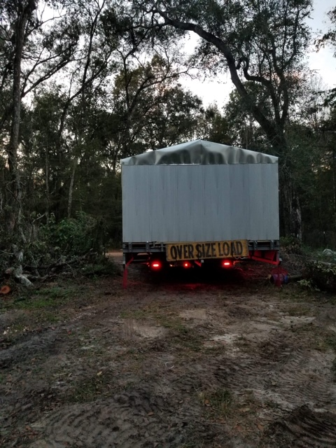 A rather Over Sized load makes its way into the farm.