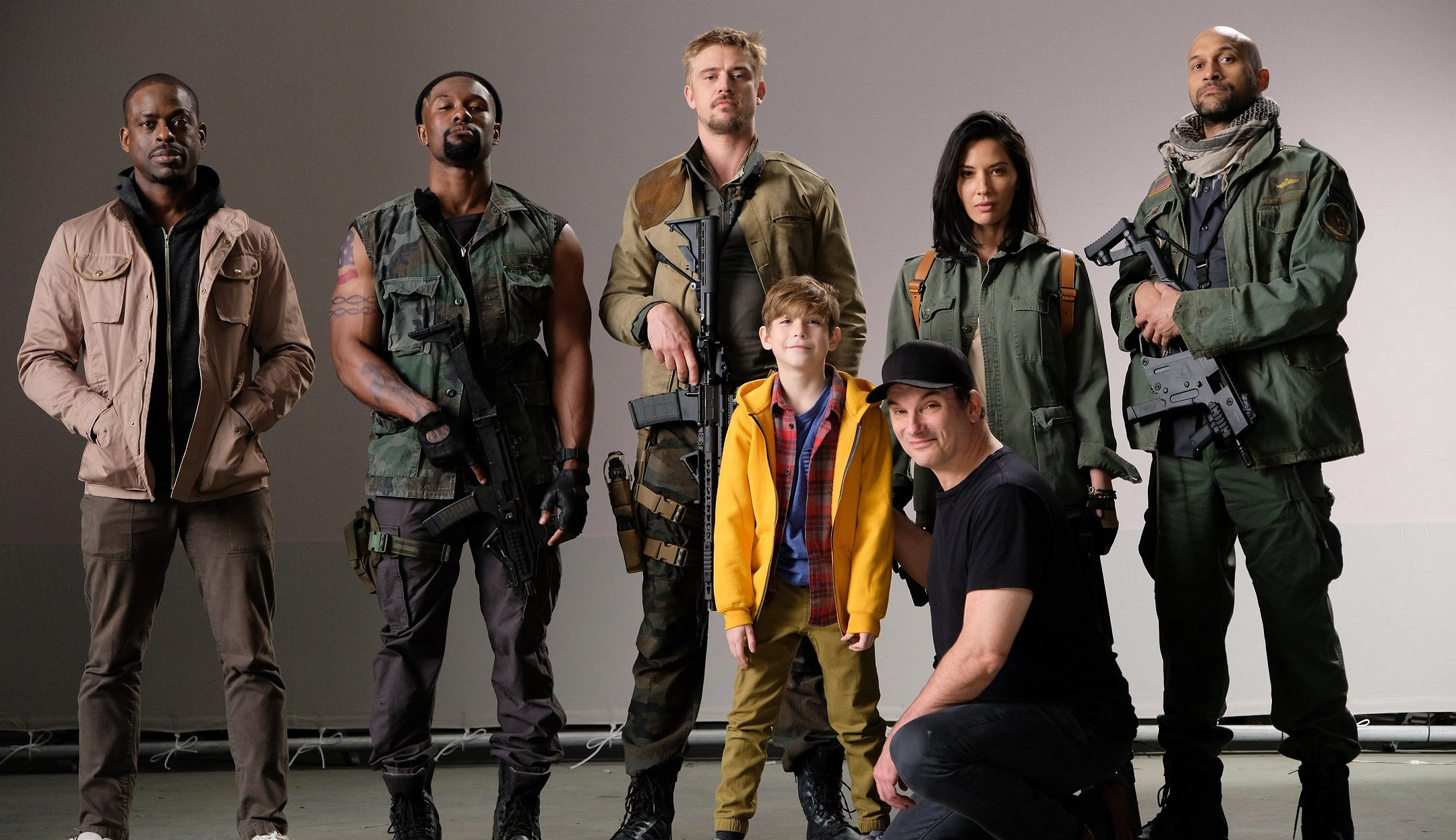 Sidebar-1-photo-The-cast-back-row-from-left-Sterling-K.-Brown-Trevante-Rhodes-Boyd-Holbrook-Olivia-Munn-Keegan-Michael-Key-front-row-Jacob-Tremblay-and-director-Shane-Black-1.jpg