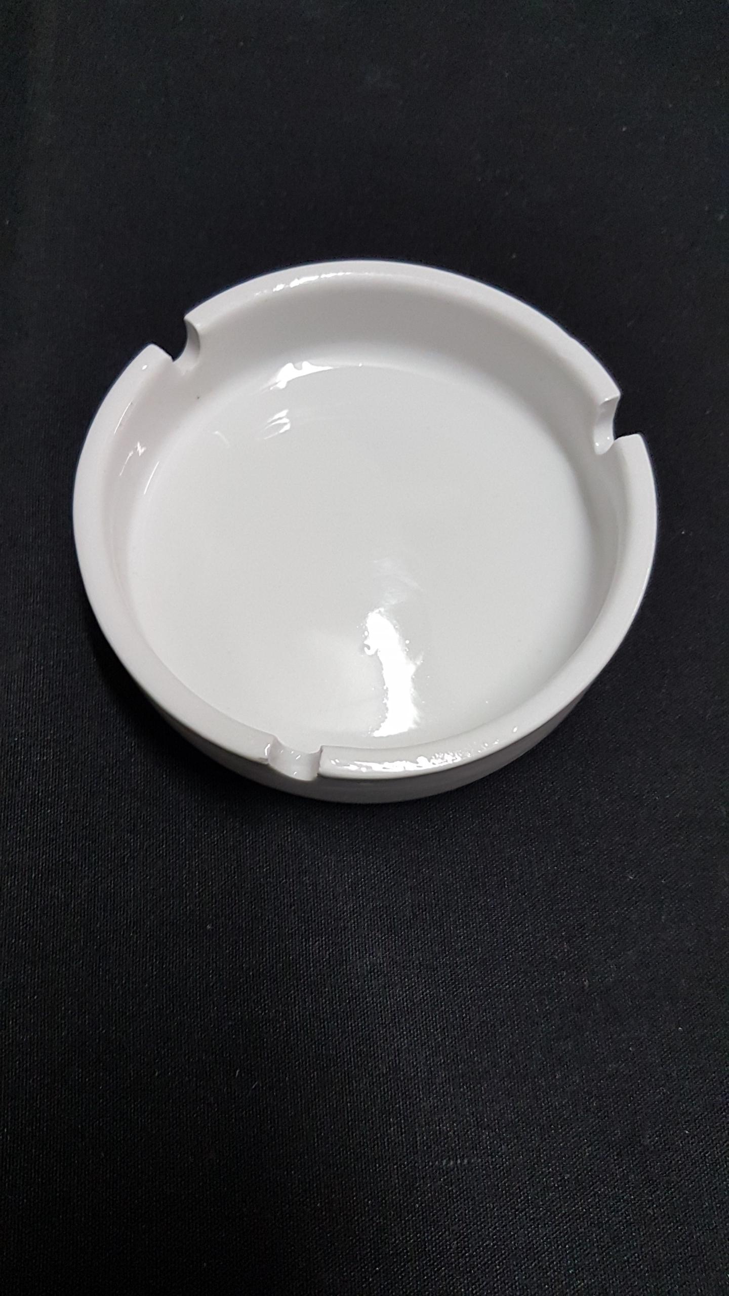 White China Ashtray $1.00ea