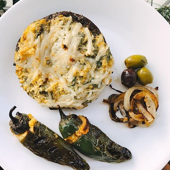 🍄 Stuffed Portobello 🍄  Marinated in balsamic vinegar, maple syrup, vegan worcestshire, stuffed with cheese + @holyhomous + chopped spinach + arugula + minced garlic + nutritional yeast. Grill for 20 minutes 👌--  @vanislandveggie . . . . . . . . #hummus #holyhomous #plantbased #vegan #vegetarian #healthyfood #veganfoodshare #fit #wellness #healthy #vancouver #victoria #foodie #dairyfree #glutenfree #garlic #nutrition #protein #portobellomushroom #stuffedportobello #maplesyrup #balsamicvinegar