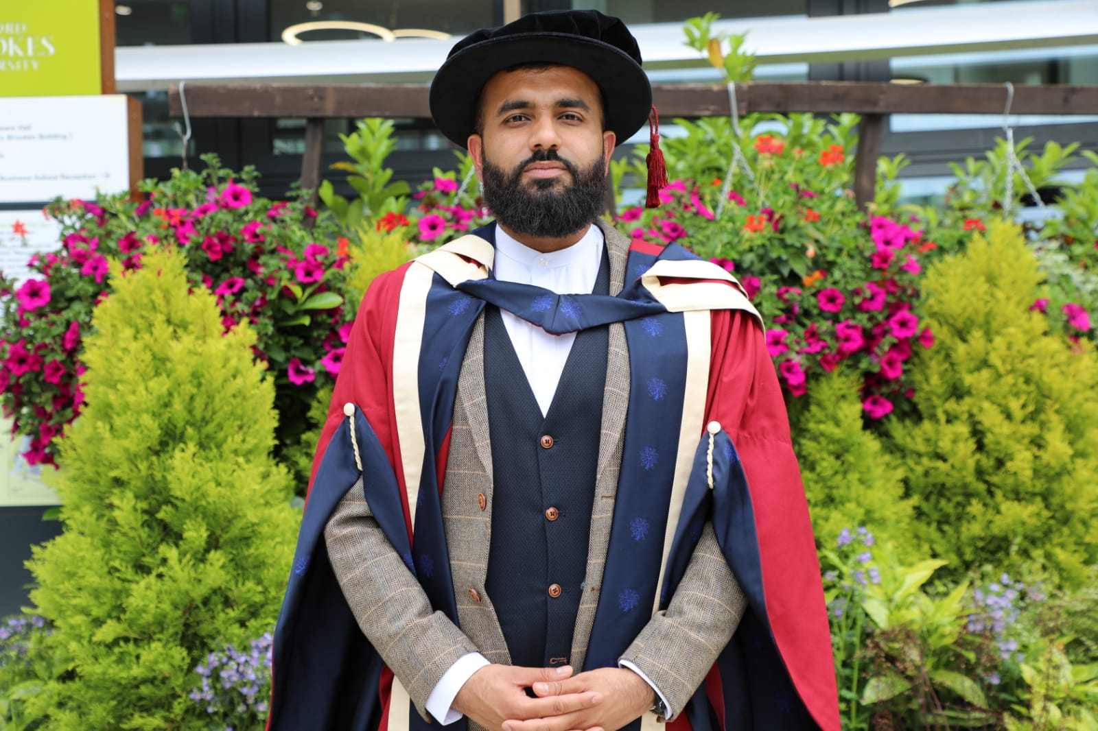 Hussain Manawer receiving a doctorate of arts from the University of Oxford Brooke's.