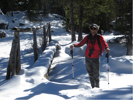 Guy Turenne and Phil Wright trekking through deep snow to find a buried stream temperature probe on Fall Creek. Photo Credit: Phil Wright, 2019.