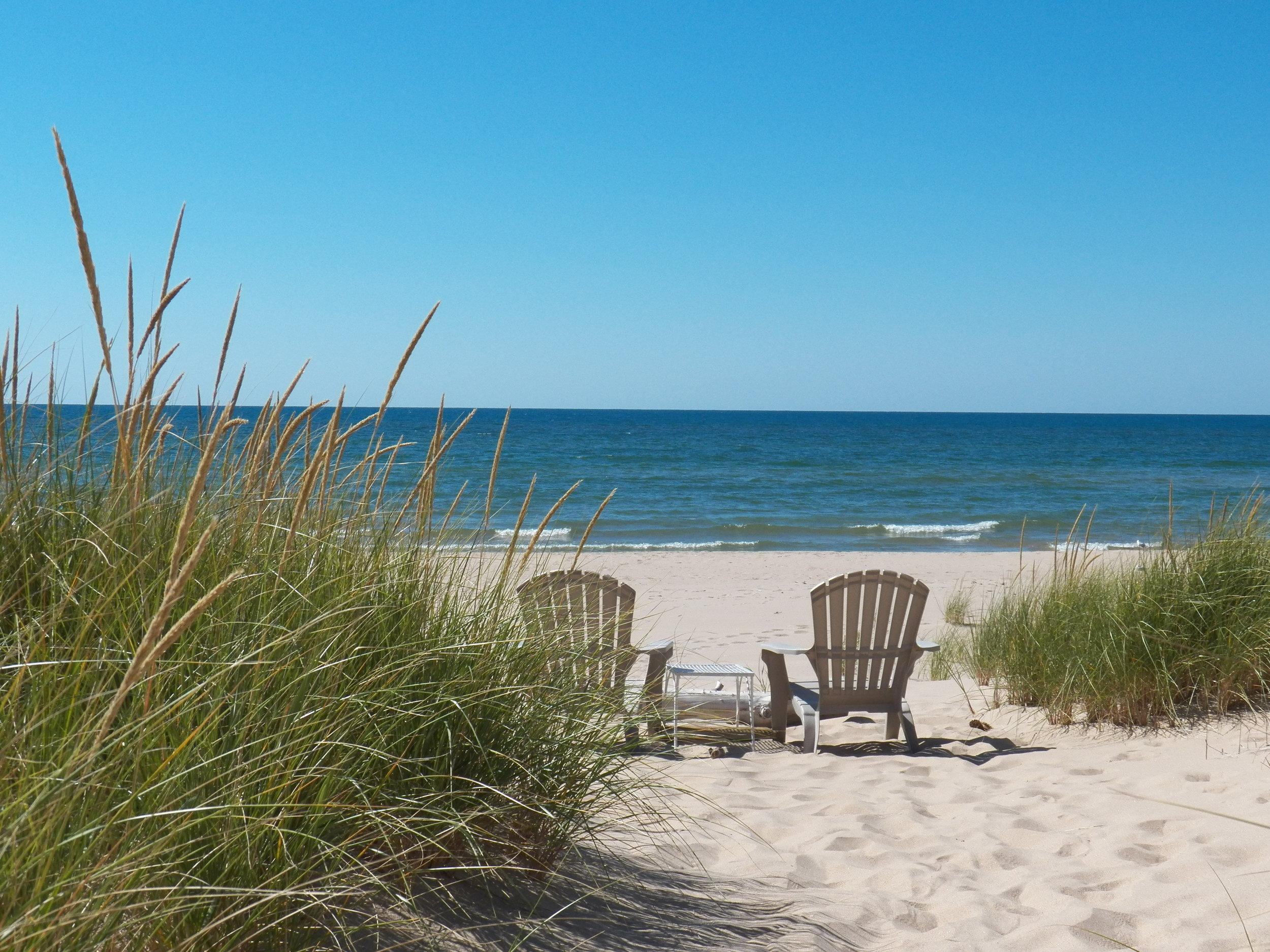 Chairs along the Lake Michigan shoreline.