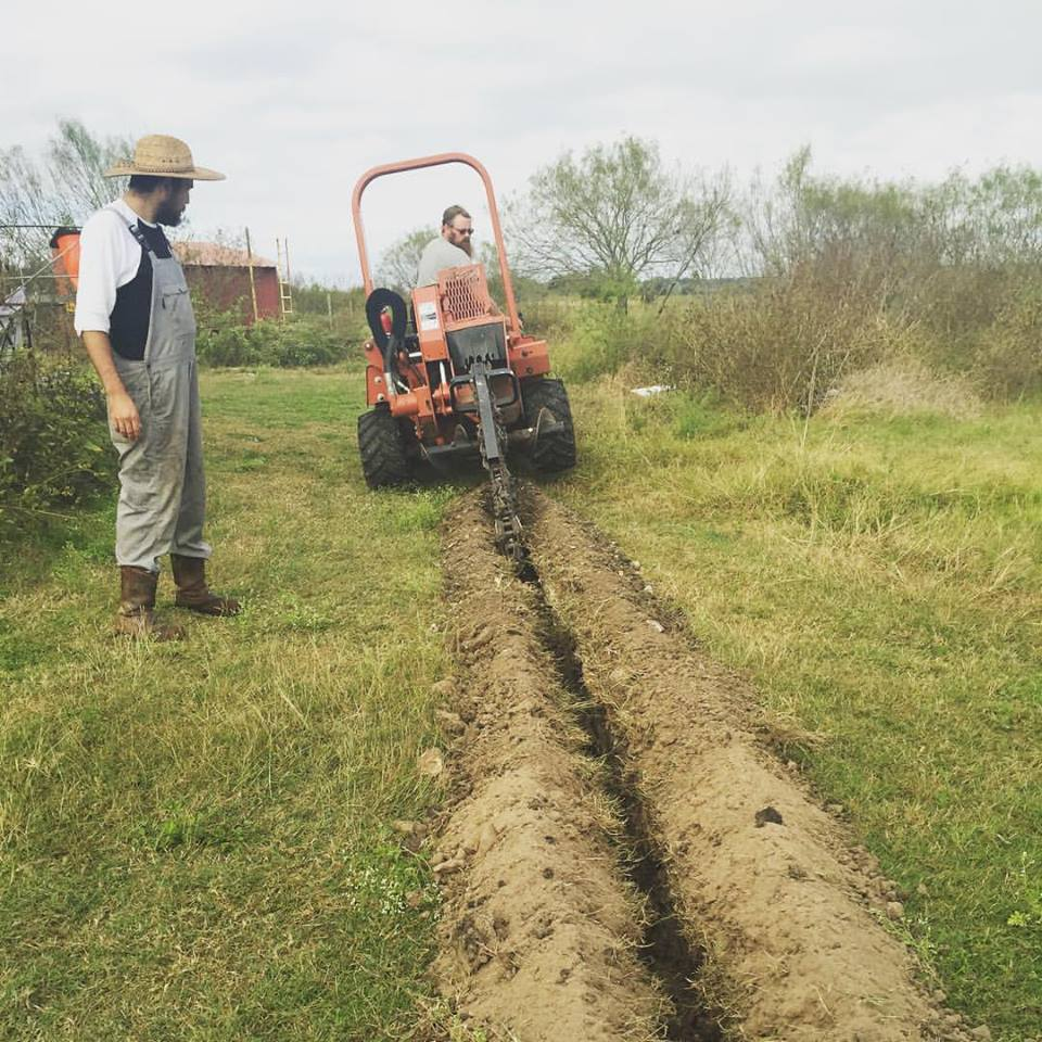 Boxcar Farm & Garden: Digging trenches to carry water to pastured pigs.