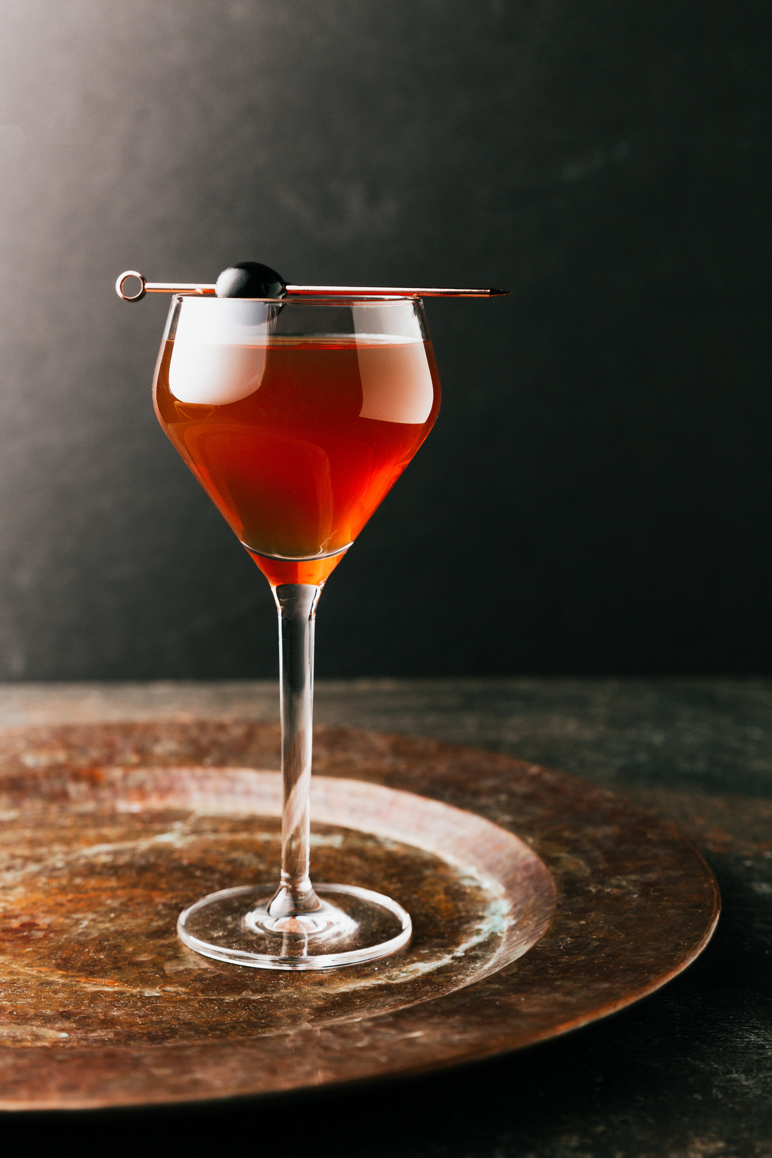 Black Manhattan    1 oz. VIGO Amaro    2 oz. Bluecoat Barrel Finished Gin    Measure the ingredients listed above into a mixing glass    Stir and serve on the rocks    Garnish with a cherry