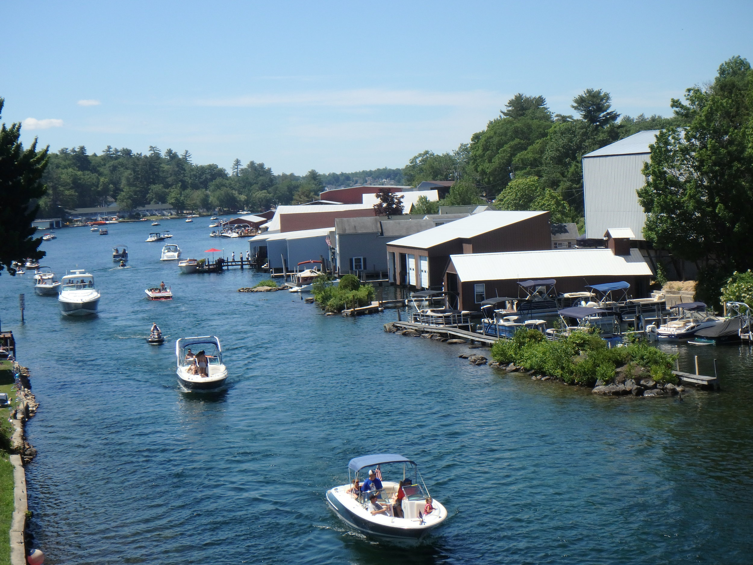 People enjoying the weekend boating. These people are heading up the Channel to Lake Winnipesaukee
