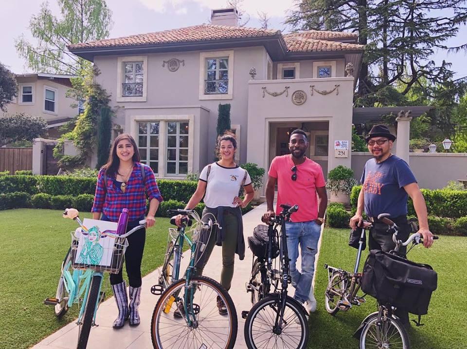 Reggie and friends biking around Modesto neighborhoods during the Artist Open Studio.