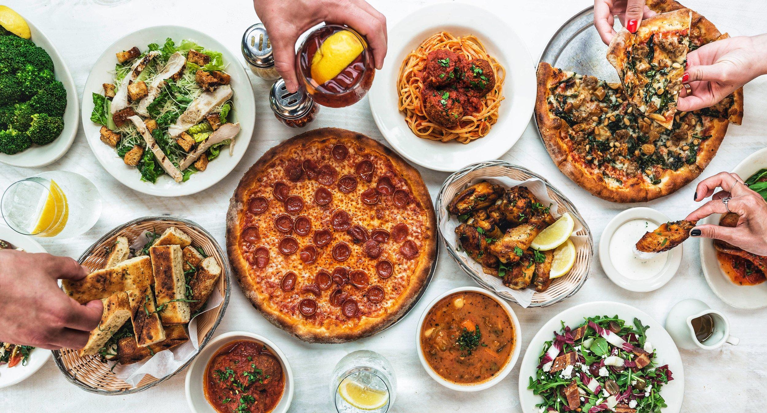 Food spread with hands grabbing food