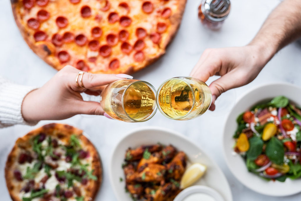 amicis-pizza-prosecco-cheers-spread.jpg