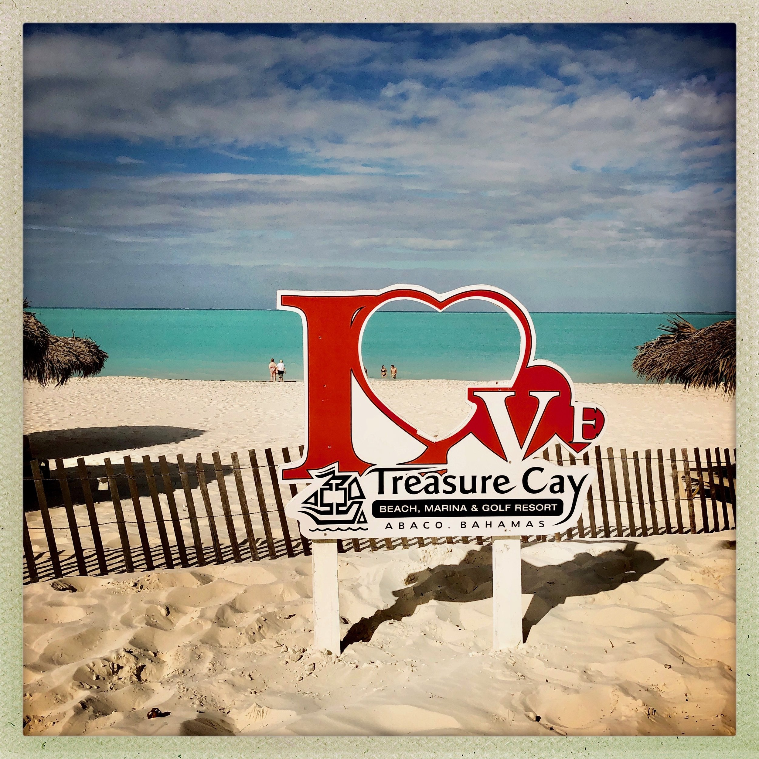 Open Air Places Treasure Cay Beach Sign.jpg