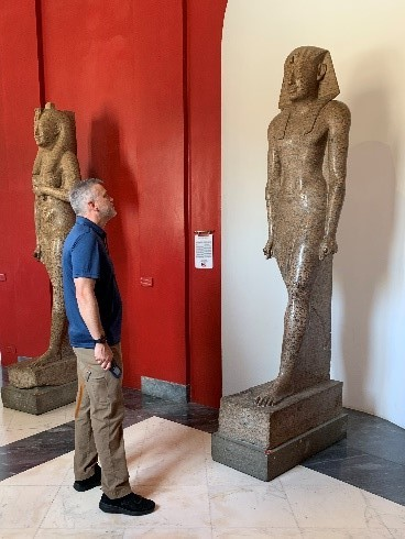 Brian doing nothing…    in wonder at the feet of a second millennium BC  Egyptian pharaoh in the Vatican Museum  Rome, Italy