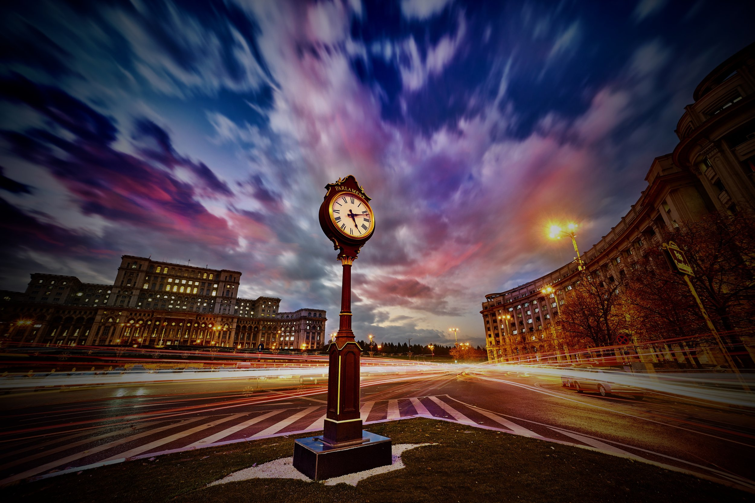 Time is passing…and always more quickly than you think. Will you join us in Bucharest?  Image: A view of a clock near the People's Palace in Bucharest, Romania.