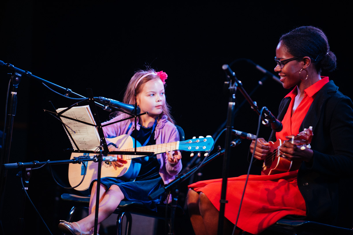little girl playing guitar at knitting factory