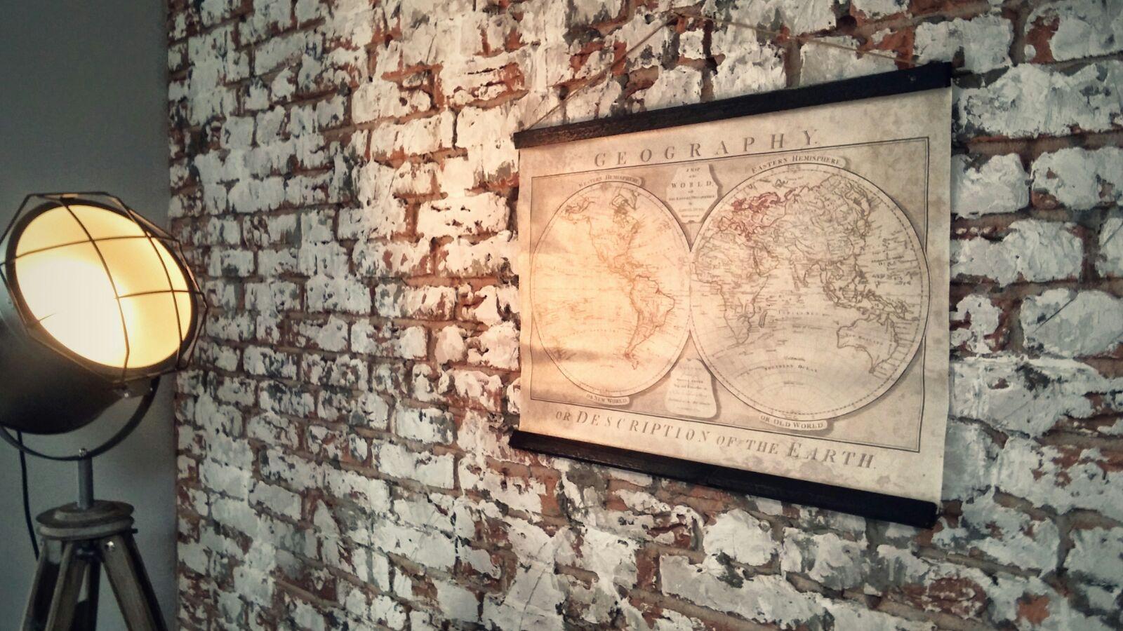 woonkamer interieurstyling industrieel brickwall bakstenen muur vintage poster.jpg