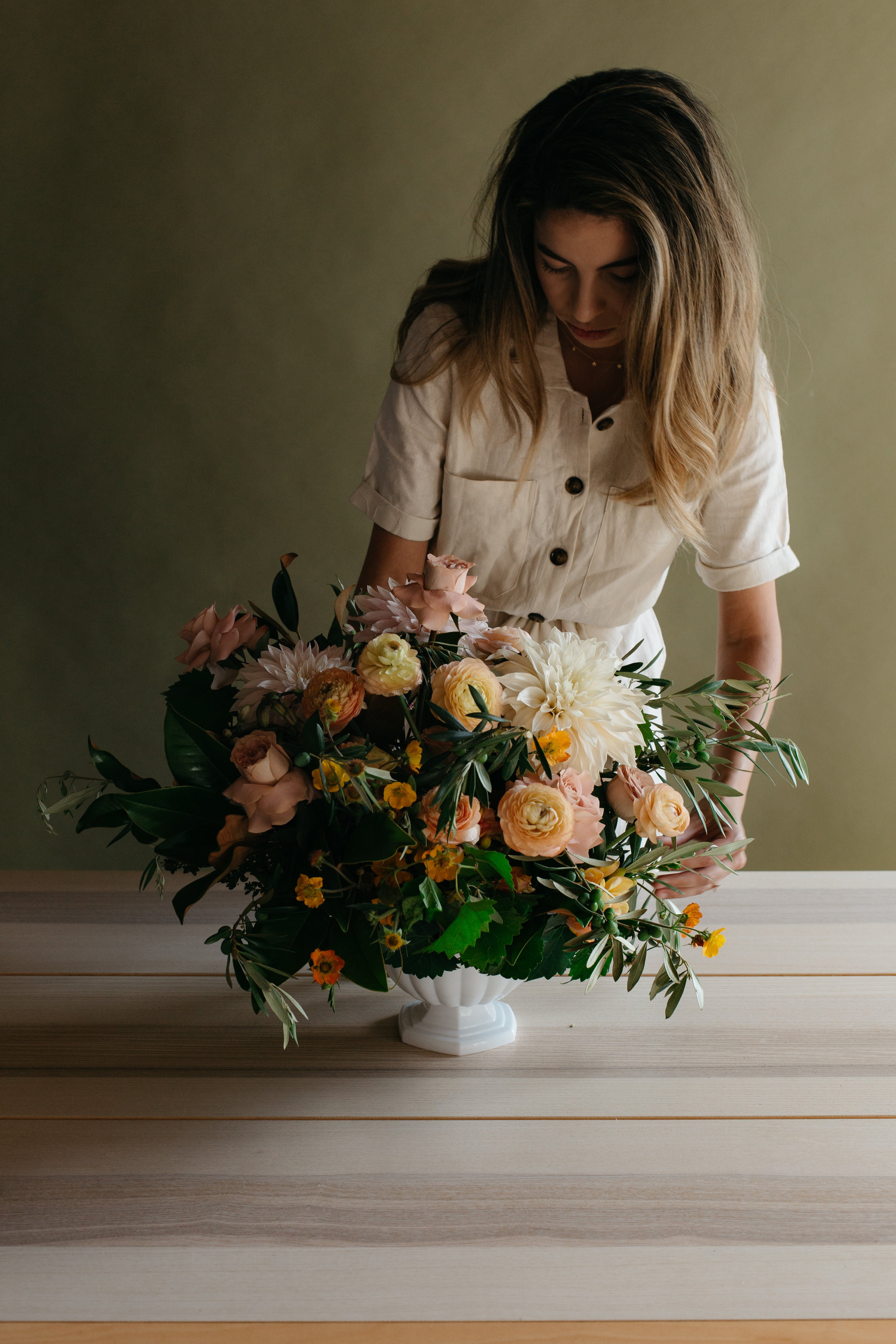 lovely to meet you. - My name is Lina and I live in Jacksonville, FL.I began to fall in love with floral design when I was planning my wedding almost five years ago and started experimenting with florals for friends' bridal showers and baby showers. I didn't realize how much I would love creating with florals as much as I've grown to.Maybe it's the the fact that blooms have the ability to make their surroundings come to life, or maybe it's the thrill in creating something from the beginning. It's a passion of mine and I am so honored to even be considered for your day.When I'm not creating with florals, you can find me devoting most of my time into helping my sweet husband fix up our first home! Life is sweet, messy, and wild... and I wouldn't have it any other way.