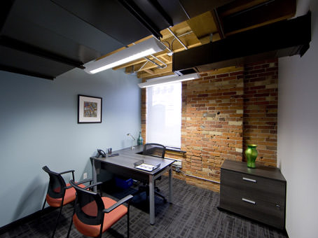 office with window and brick wall