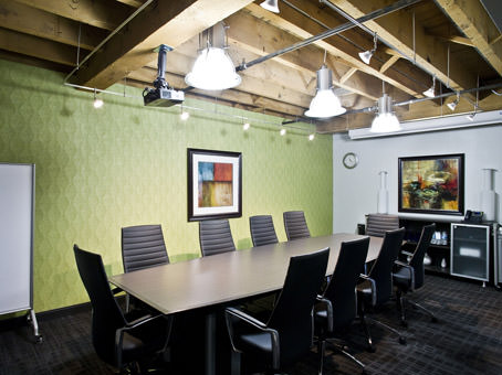 boardroom with brick and a green wall