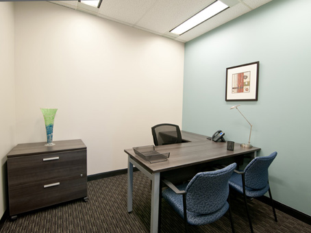 single internal office with two client chairs
