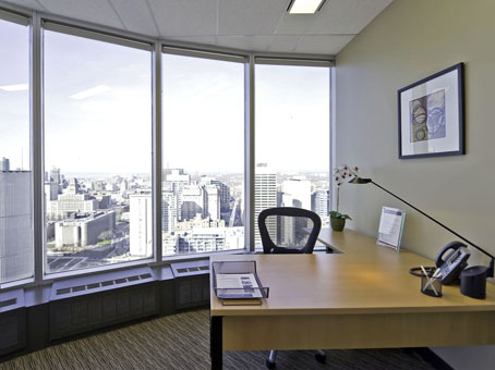 executive corner office with large windows