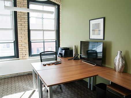 office with lots of natural light and brick wall