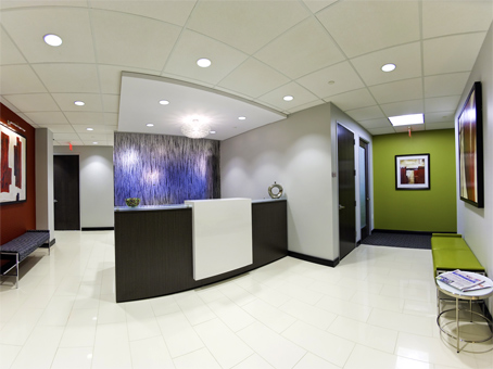 reception area with white floor and green accent walls