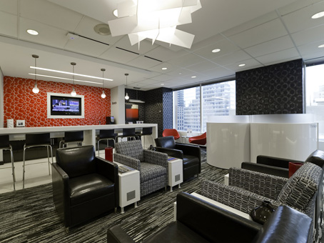 business lounge and waiting area with couches and electrical outlets