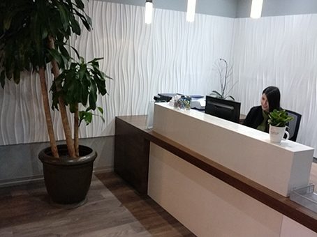 reception area with seated receptionist