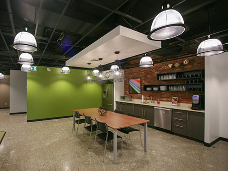 touch of green wall with long table