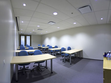 training room with wooden table and blue color chairs
