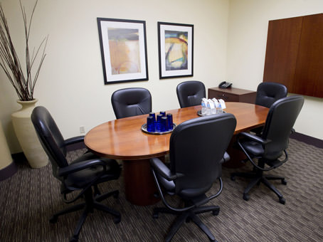 small meeting room with wooden table