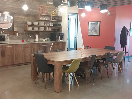 long table and chairs in a coffee area
